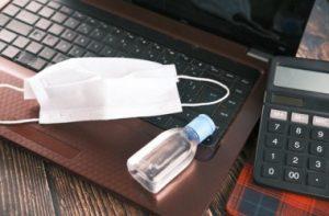 1-surgical-masks-hand-sanitizer-on-office-desk_260672-3644_i