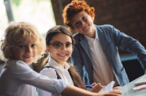 school-three-cute-kids-studying-classroom-feeling-excited_i